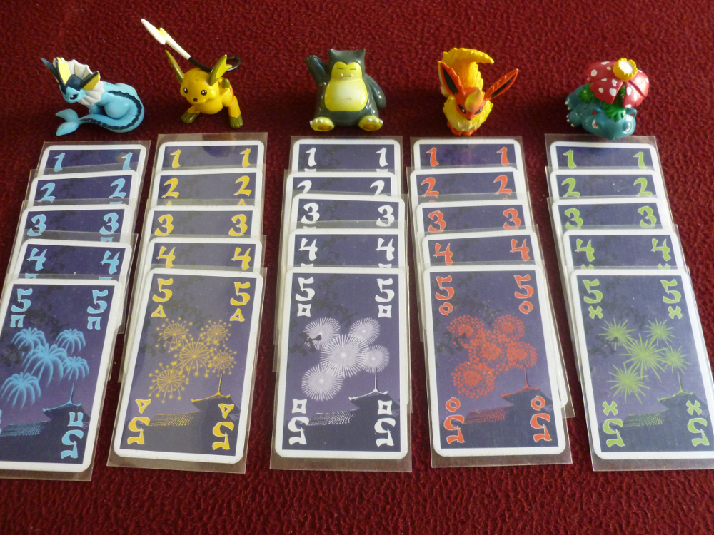 All the Hanabi cards and some Pokemon figurines
